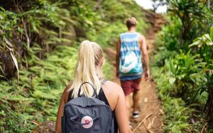 2 people hiking together