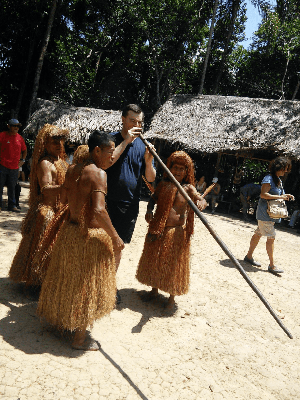Deepest Darkest Peru shooting a dart with the tribe Iquitos